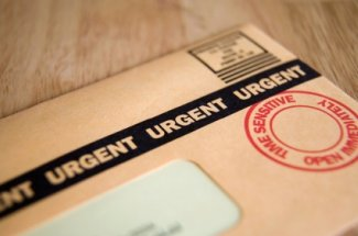 time barred debt brown envelope with urgent on it